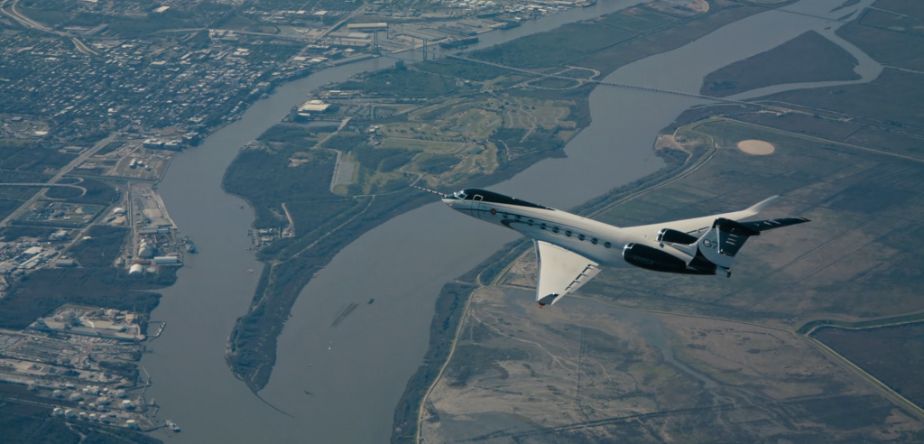 gulfstream g700 business jet test aircraft flying over a river