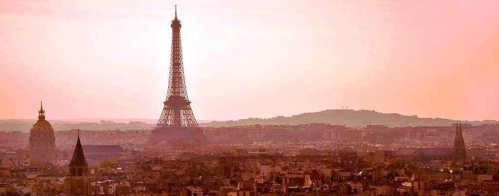 image of the city of paris with evening sky